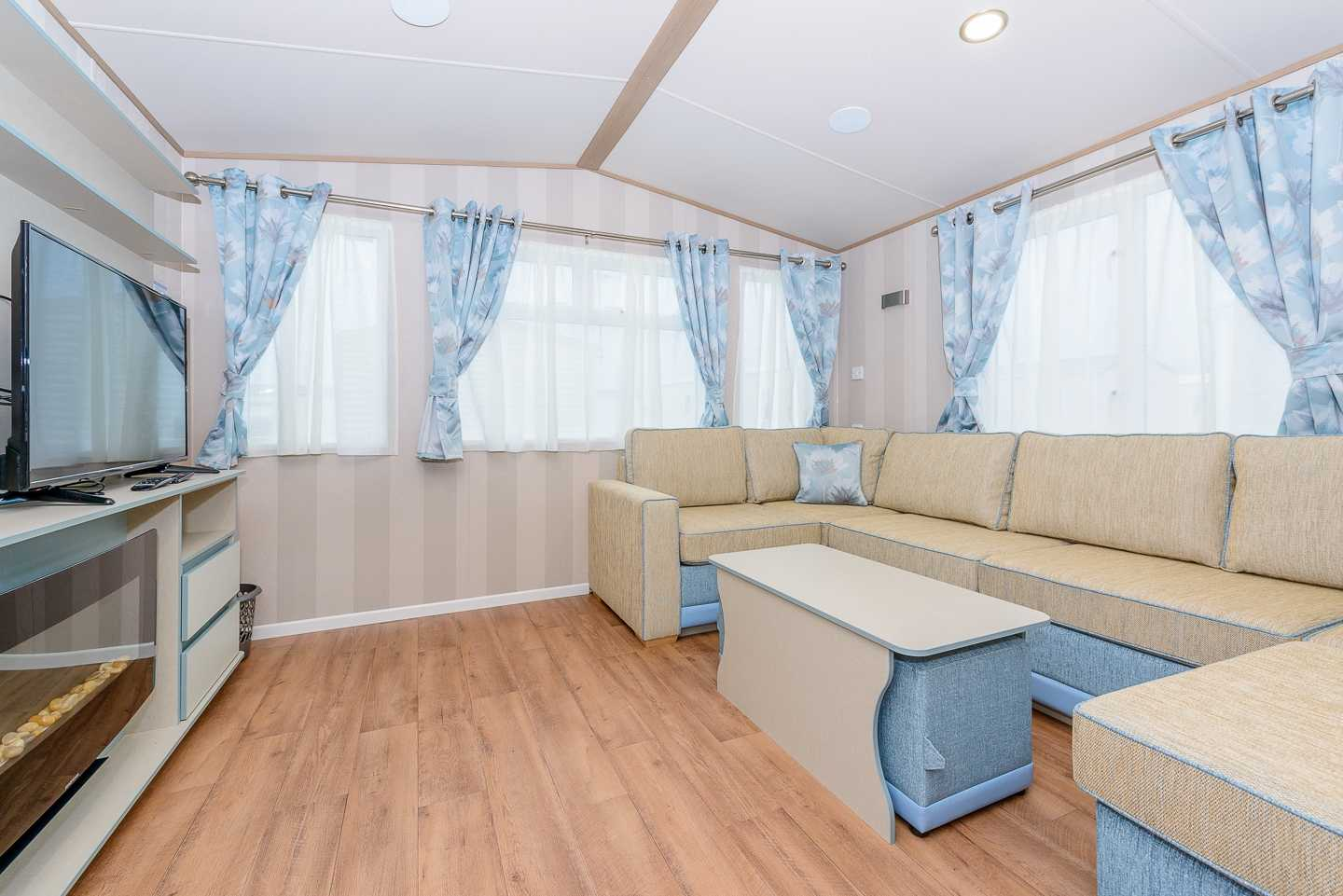 An example of the lounge in a Prestige with Decking caravan