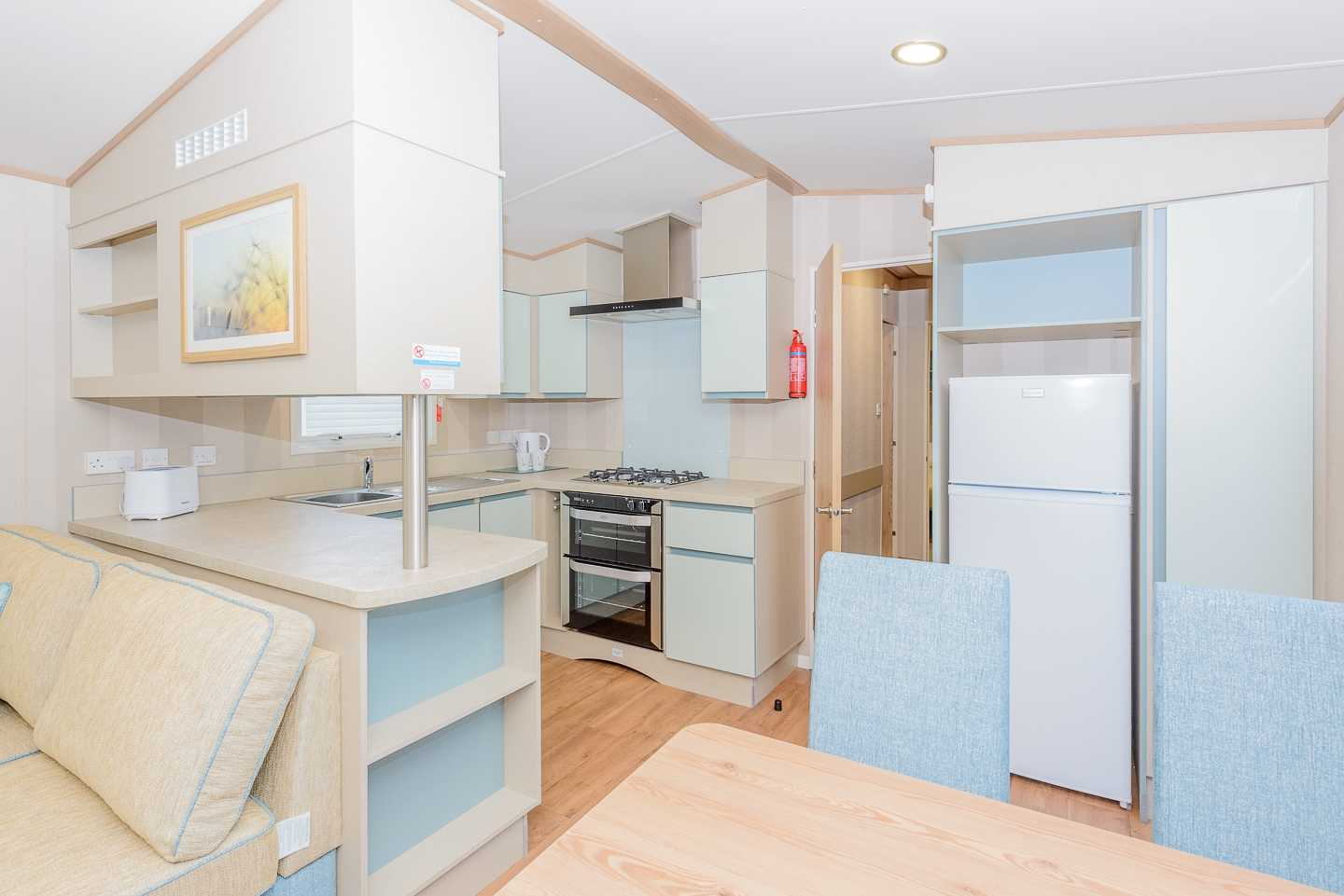 An example of the kitchen in a Prestige caravan