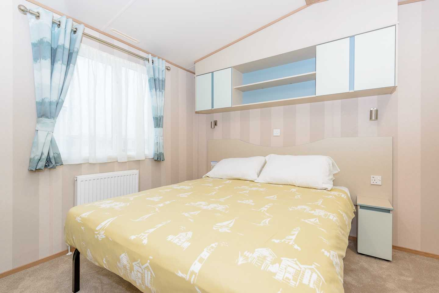 An example of the master bedroom in a Prestige with Decking caravan