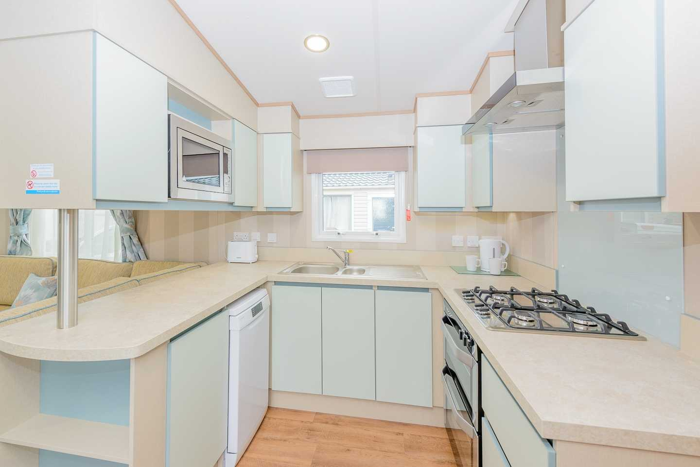 An example of the kitchen in a Prestige with Decking caravan