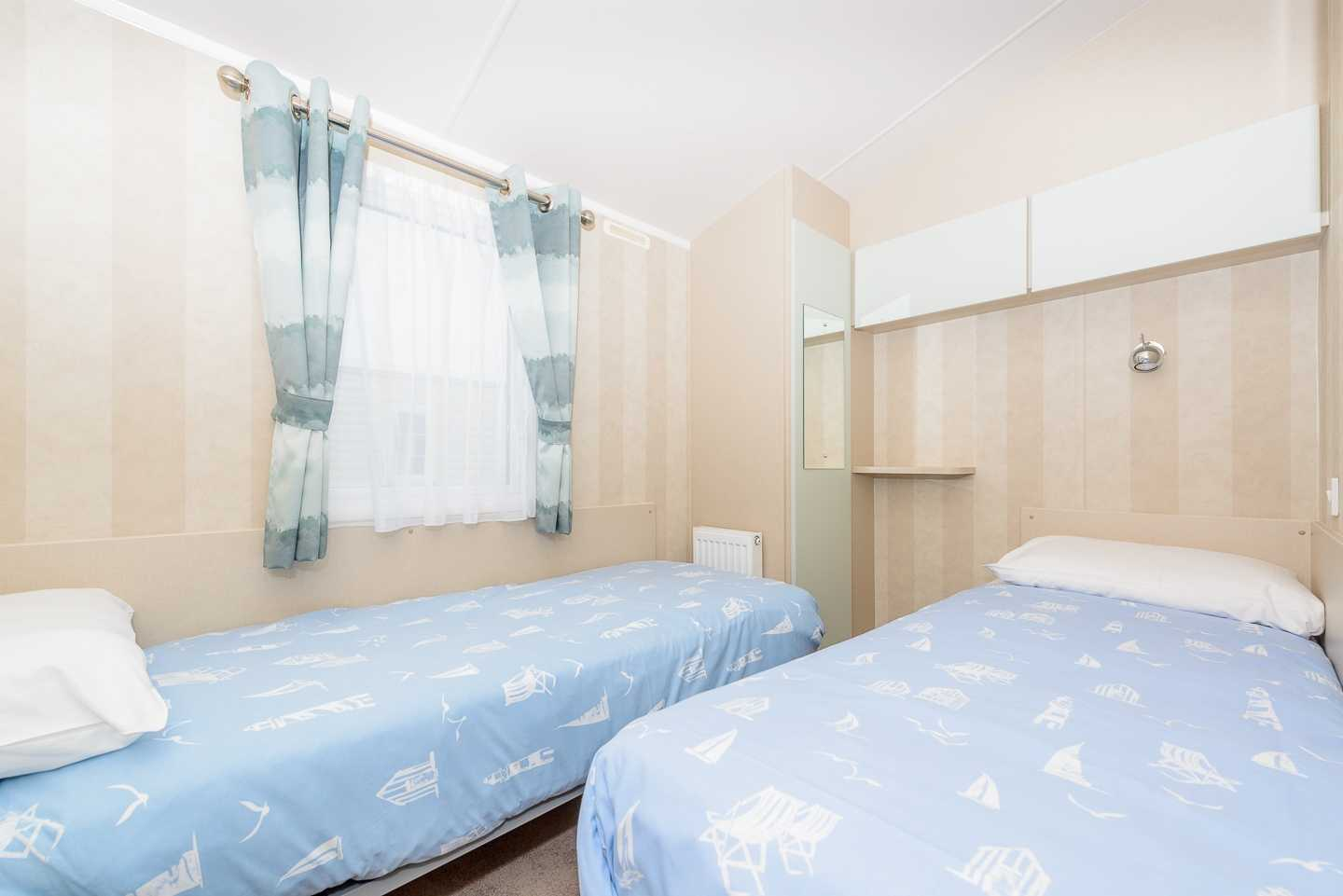 An example of the twin bedroom in a Prestige with Decking caravan