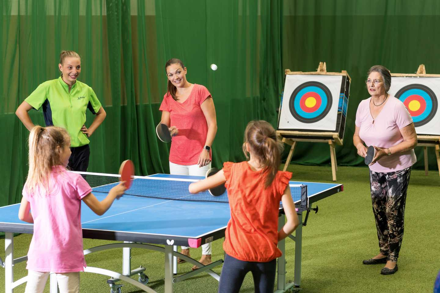 Guests playing table tennis in the all-weather Activity Barn at Thornwick Bay