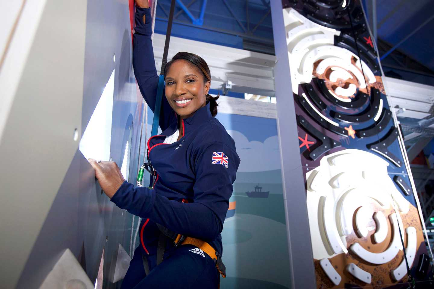 Denise Lewis scaling the Crazy Climber