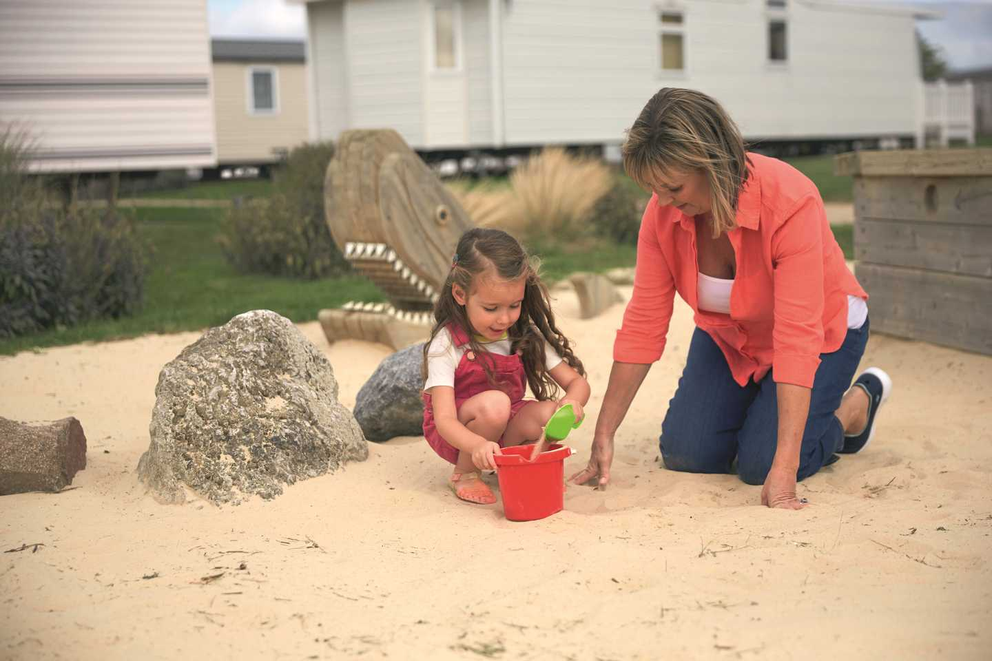 A mother and daughter building sandcastles