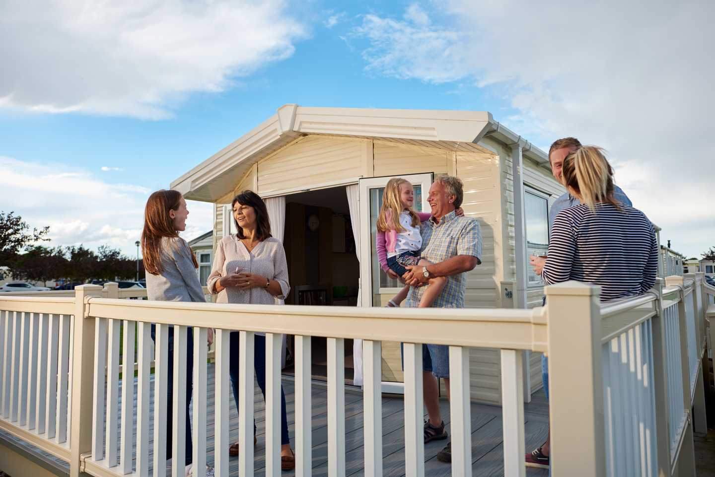 A family hanging out together on their veranda at Golden Sands