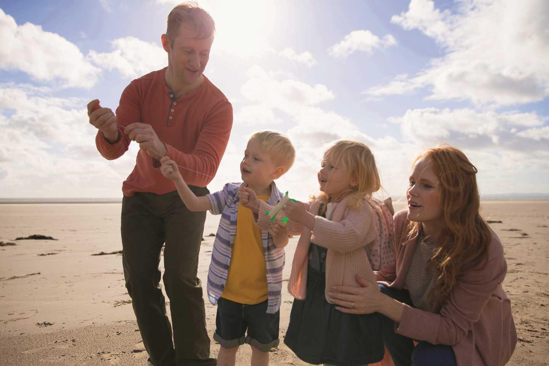 A family having fun on the beach