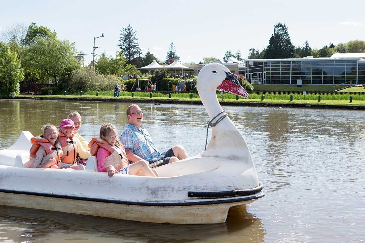 A family in a pedalo on the boating lake