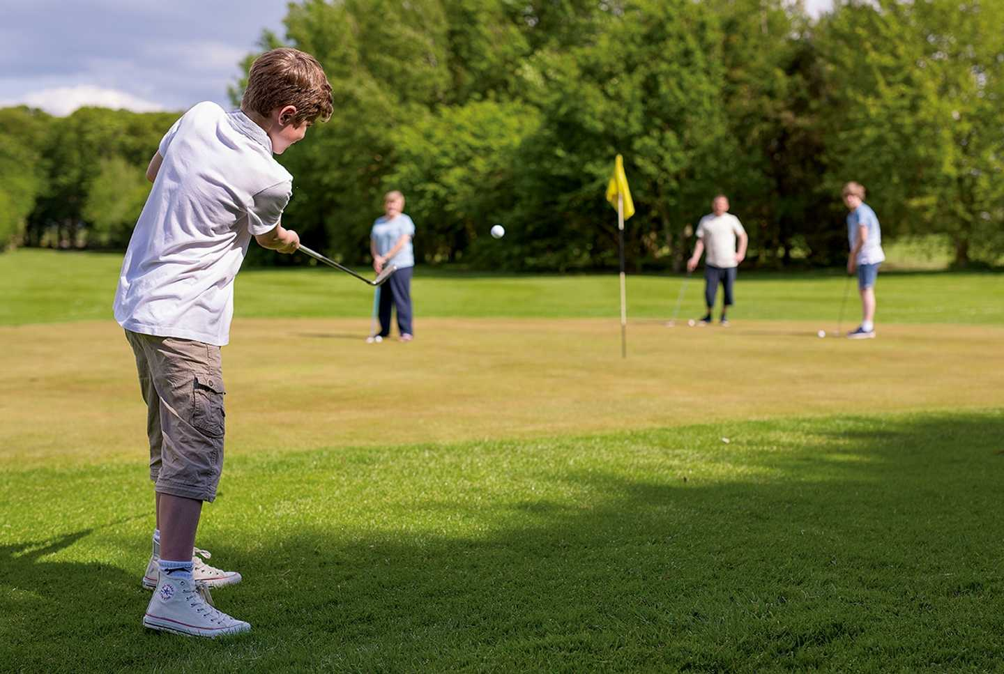 Guests playing a round of golf on the 9-hole golf course