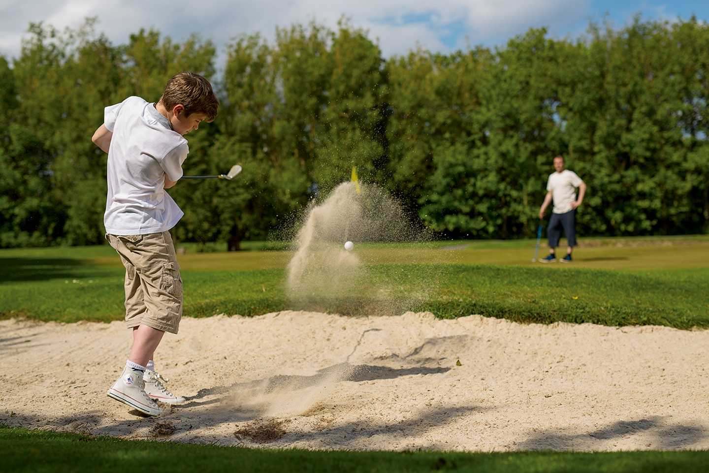 Guests playing on the 9-hole golf course