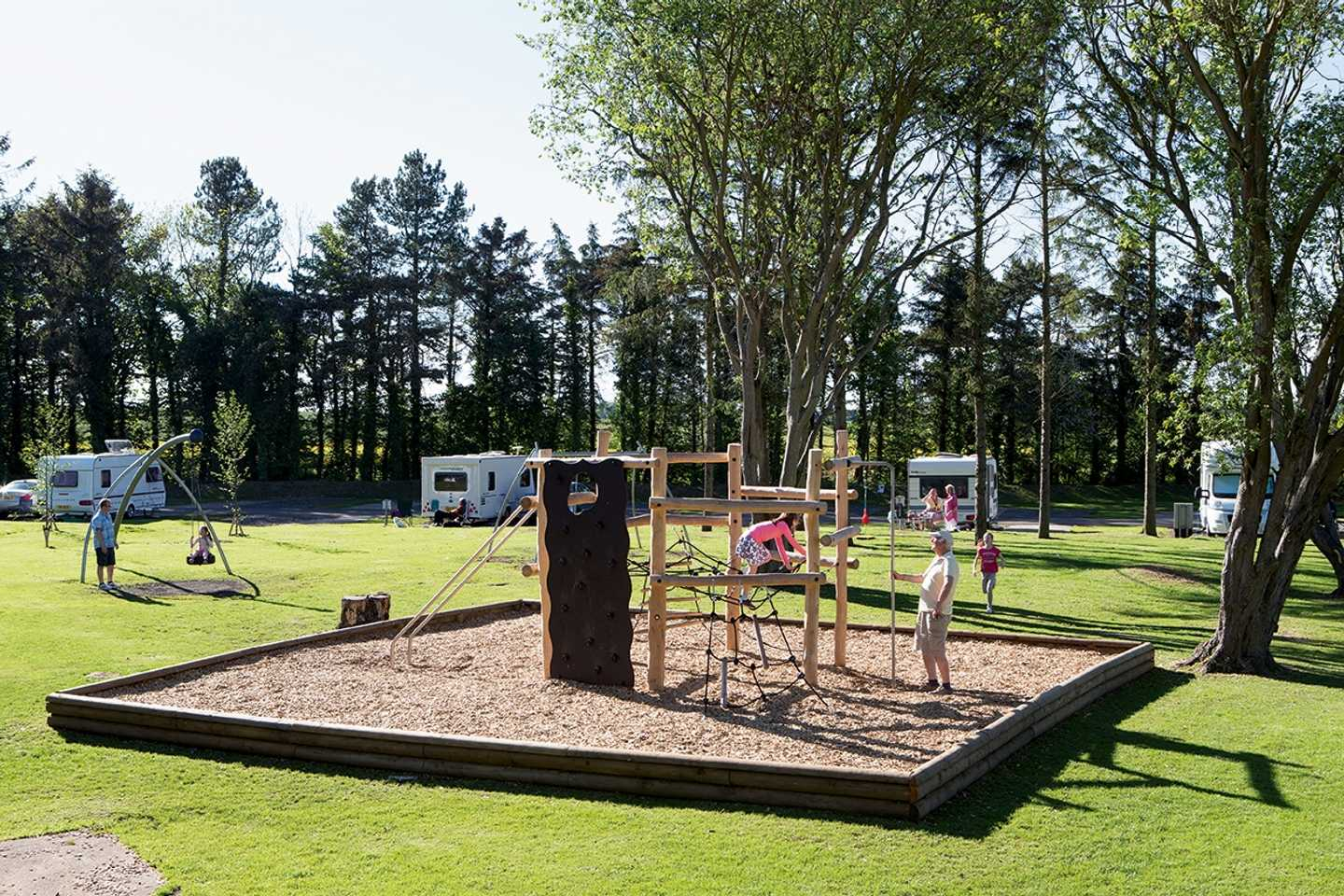 Guests in the touring play area at Haggerston Castle