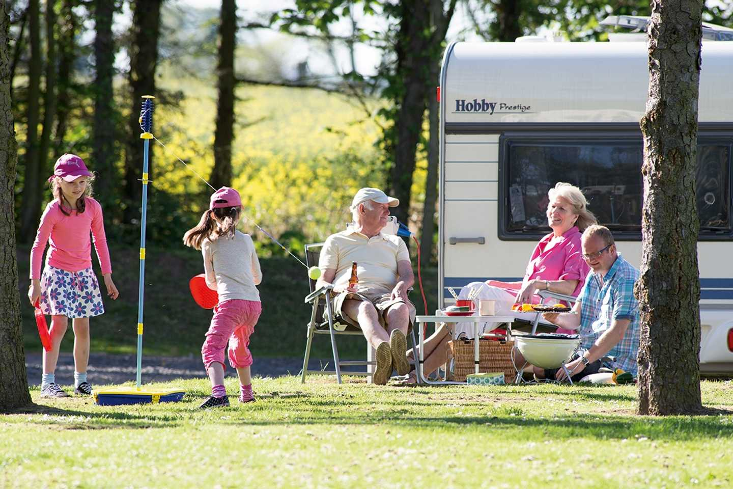 Guests playing games outside their caravan