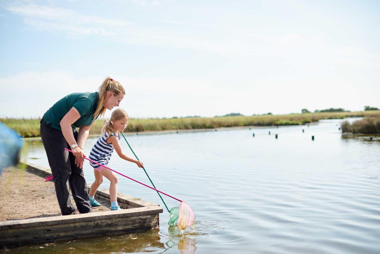 Ranger with children pond dipping