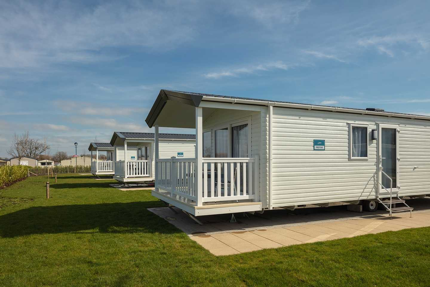 View of the front of a Prestige with decking caravan at Dalrymple Village or Balmoral