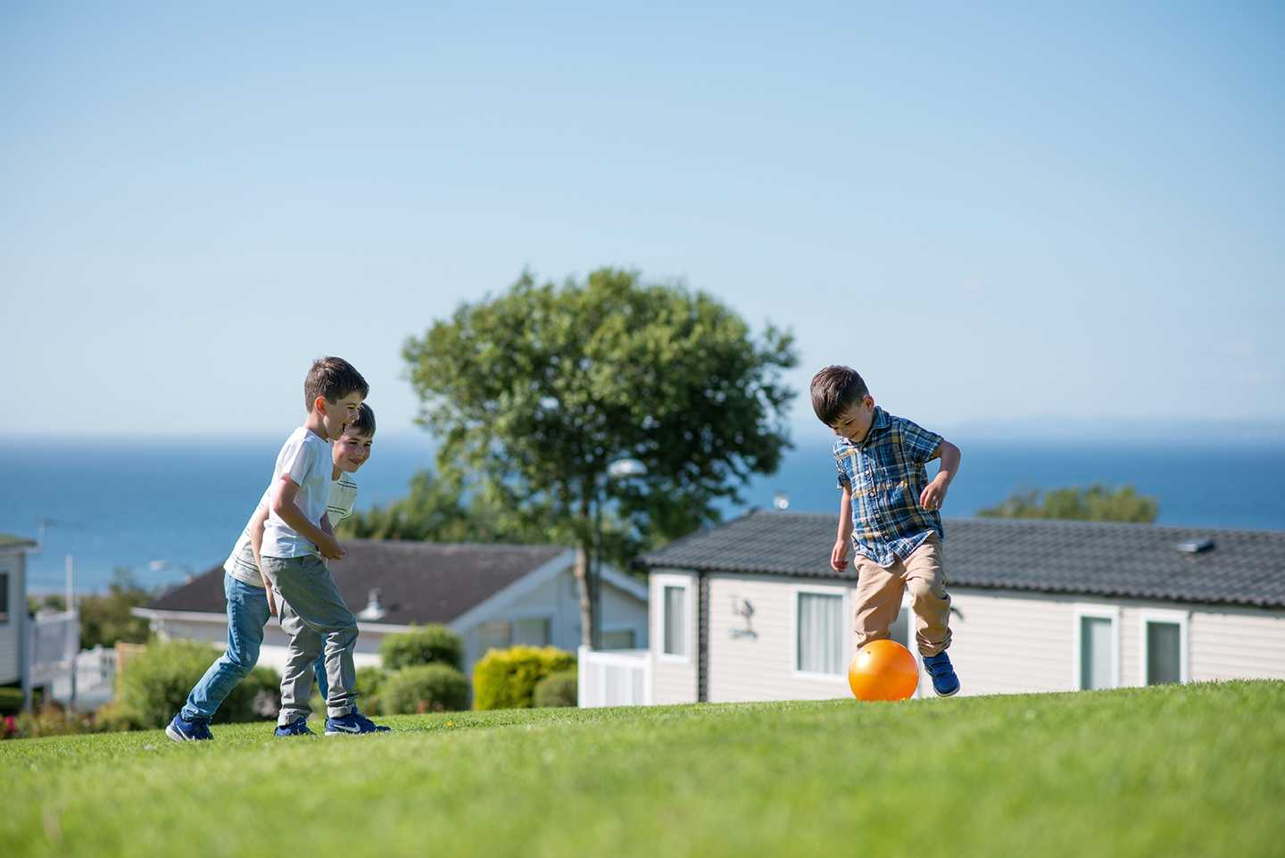 Guests playing football within Craig Tara's grounds
