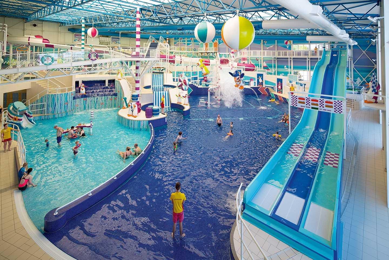 Guests enjoying the indoor pool