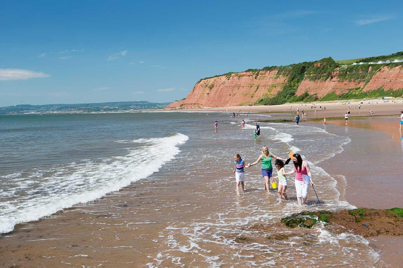 People along the seashore at Sandy Bay