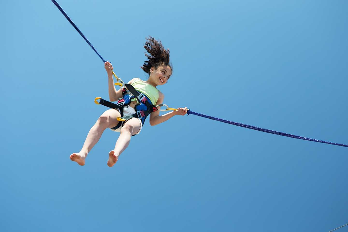 Girl doing the bungee trampoline activity