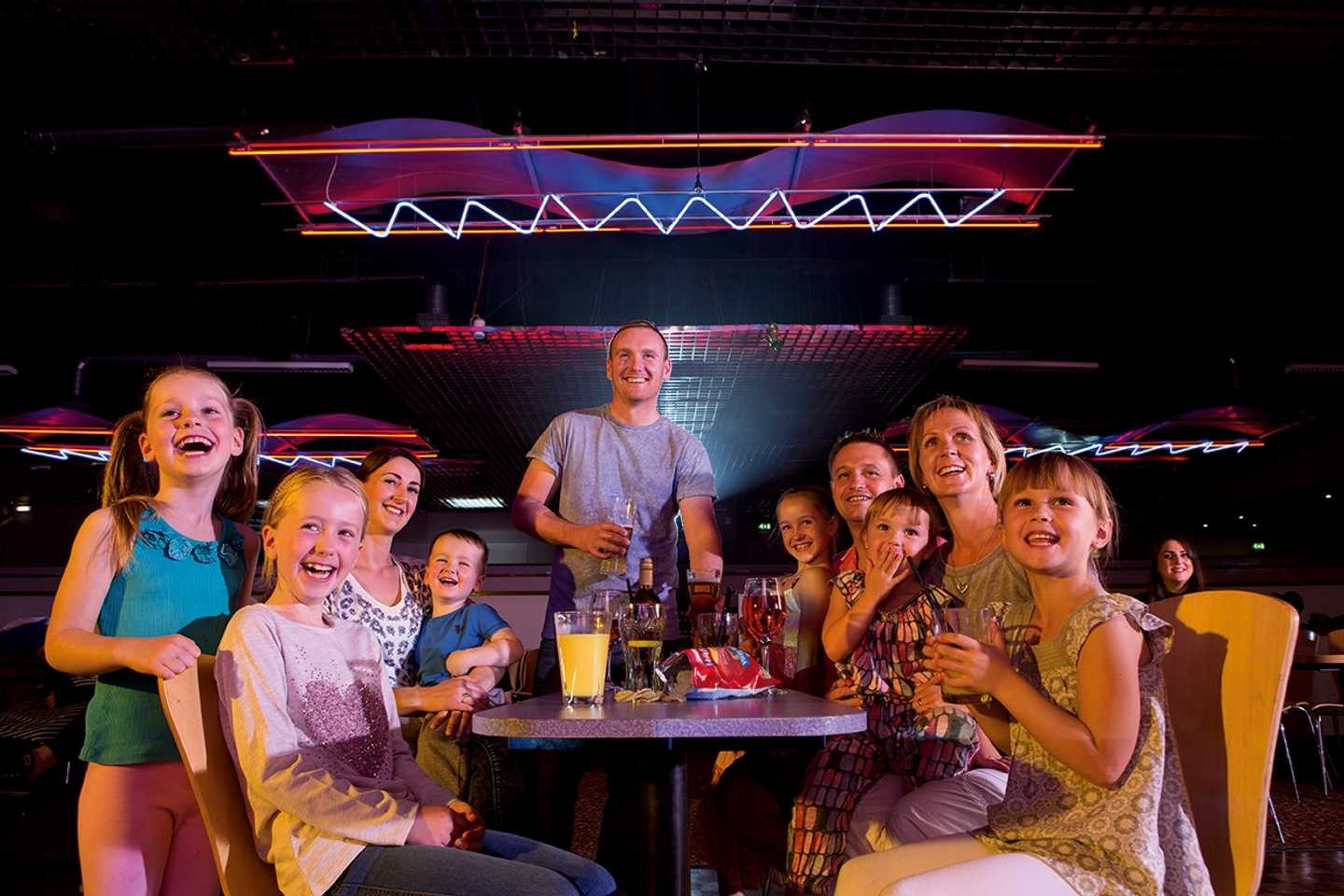Family enjoying the entertainment in Bugsy's ShowBar at Devon Cliffs