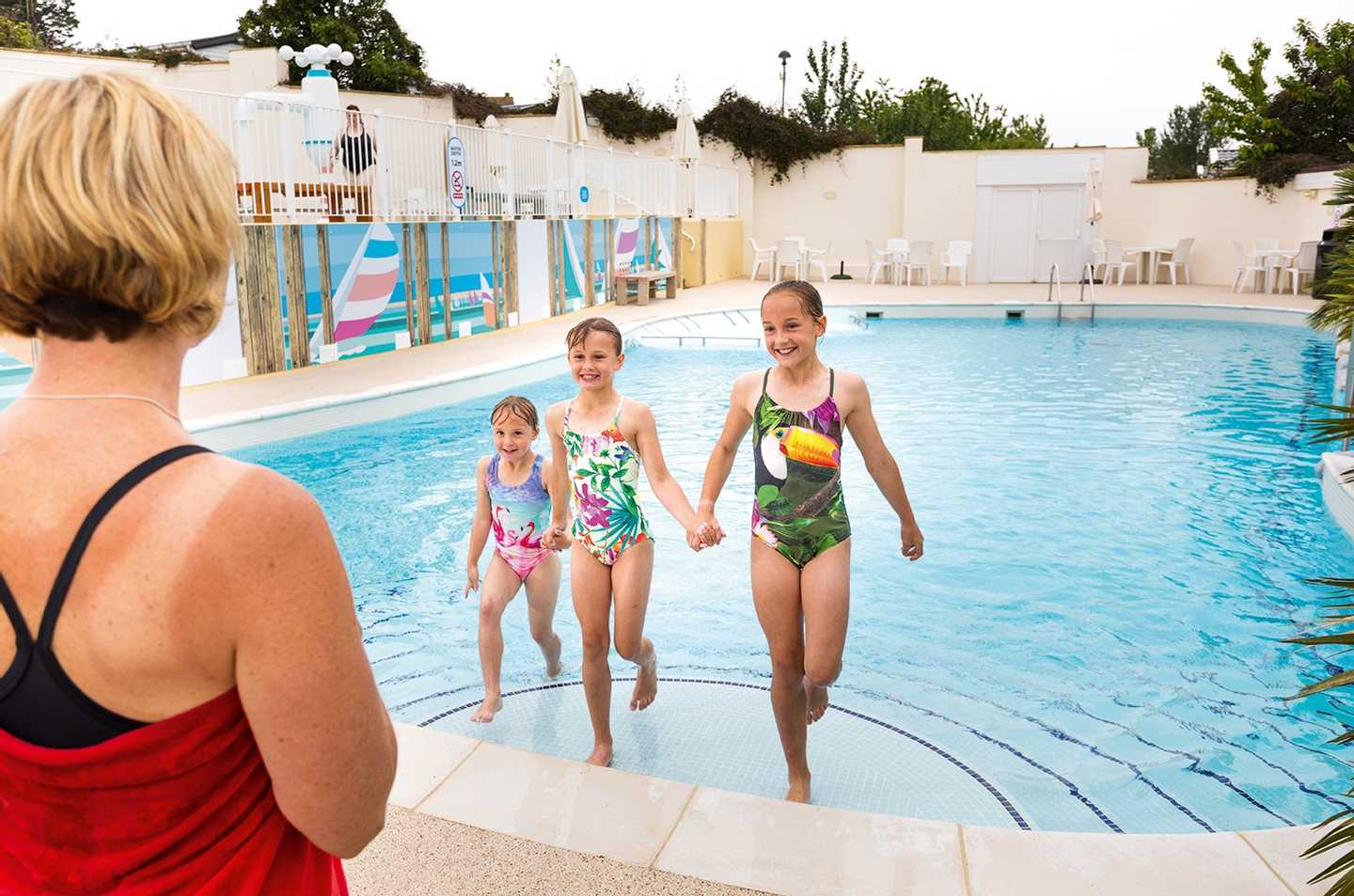 A group of children in the outdoor pool