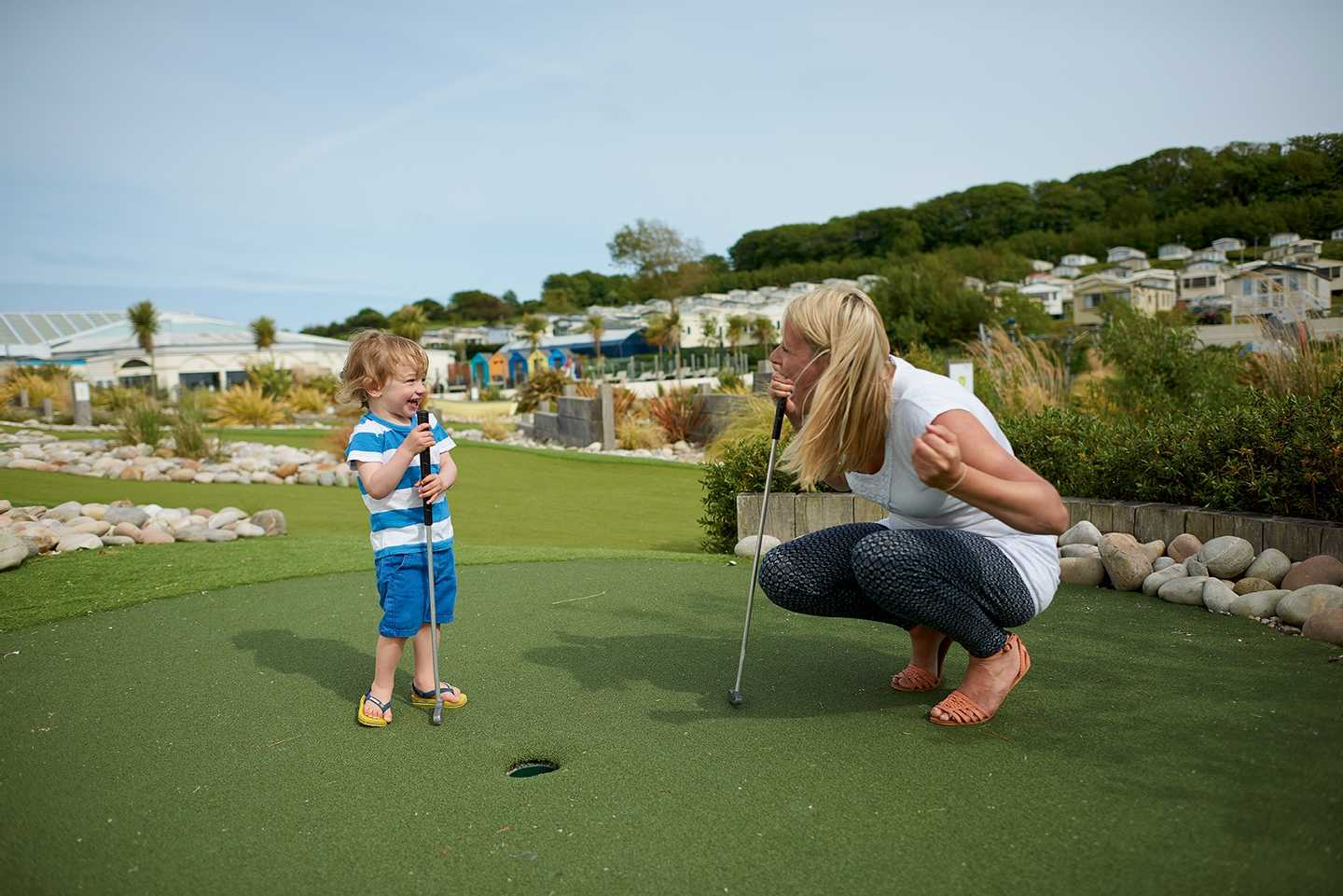 Mother and child having fun playing adventure golf at Littlesea