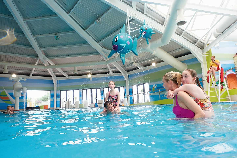 Family having fun in the heated indoor pool