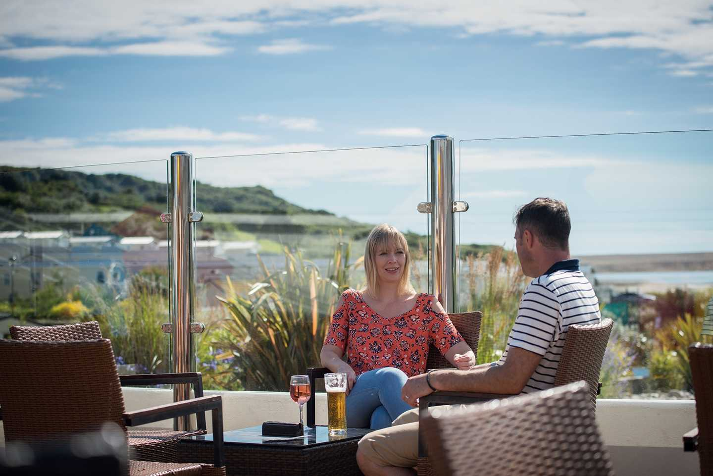 Couple dining on the Mash and Barrel terrace