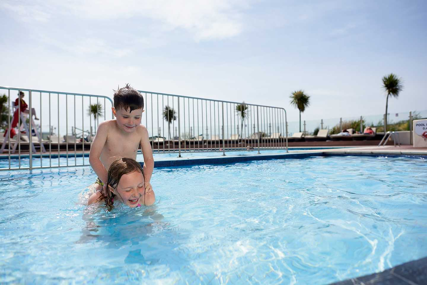 Guests playing in the outdoor pool at Littlesea Holiday Park