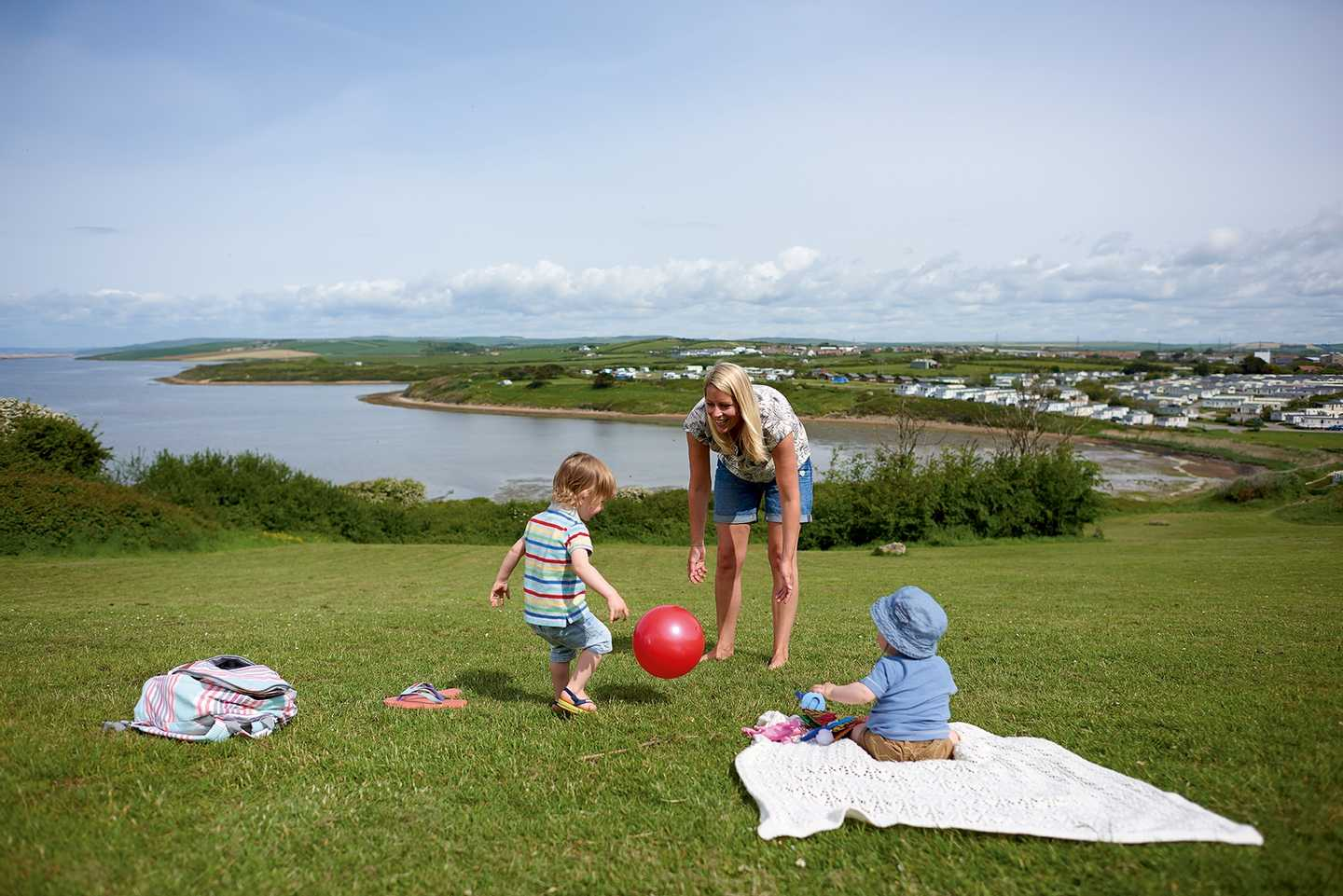 Family enjoying the wide open spaces at Littlesea Holiday Park