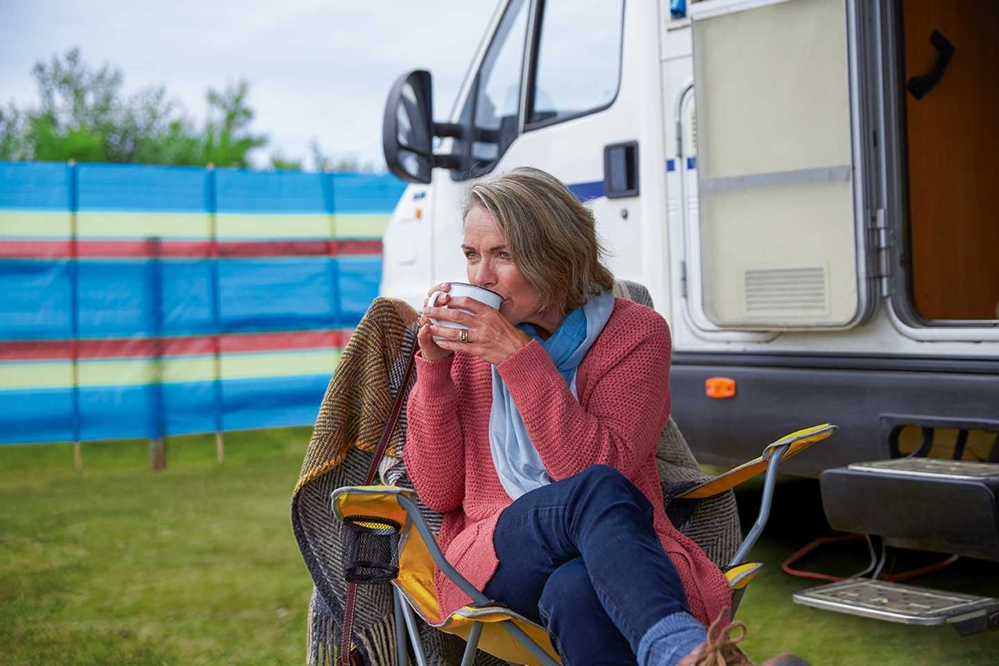 A guest sitting outside her motorhome