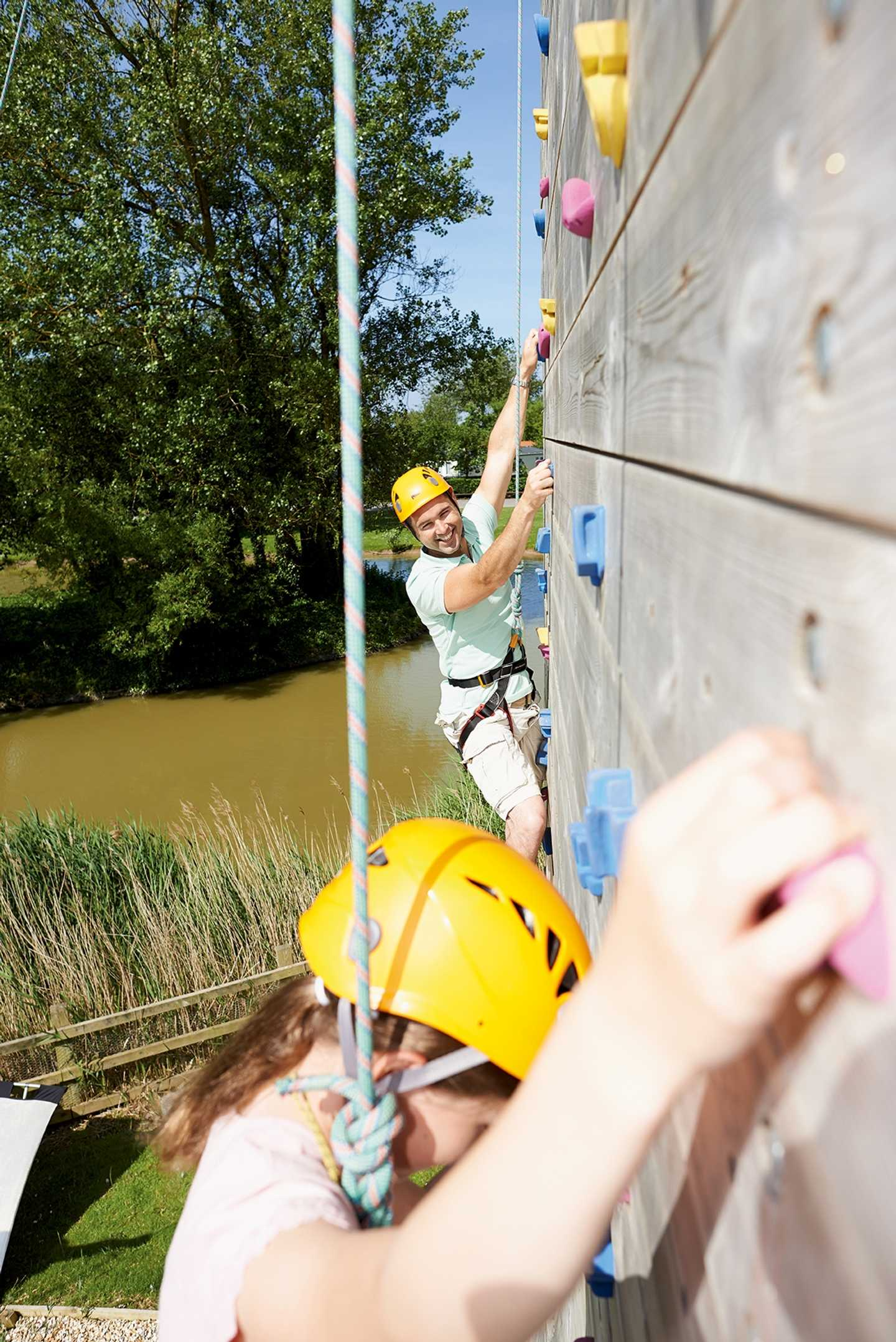 Children scaling the climbing wall