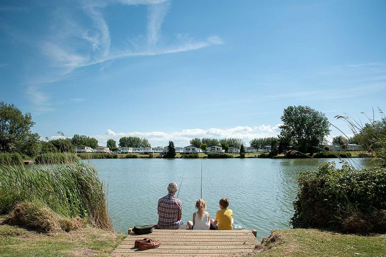 Family fishing at the fishing lake