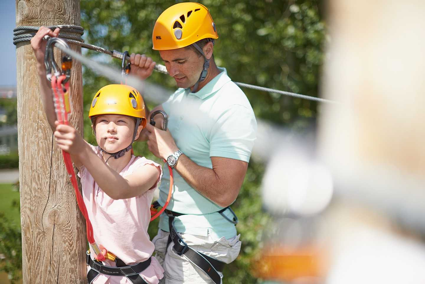 A young guest and father on the ropes course at Burnham-on-Sea
