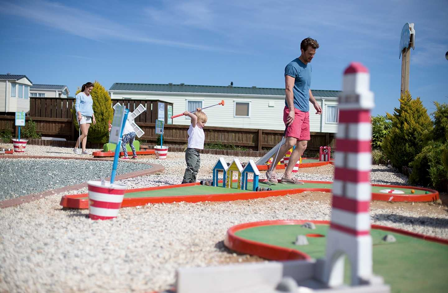 Family playing on the crazy golf course at Blue Dolphin Holiday Park