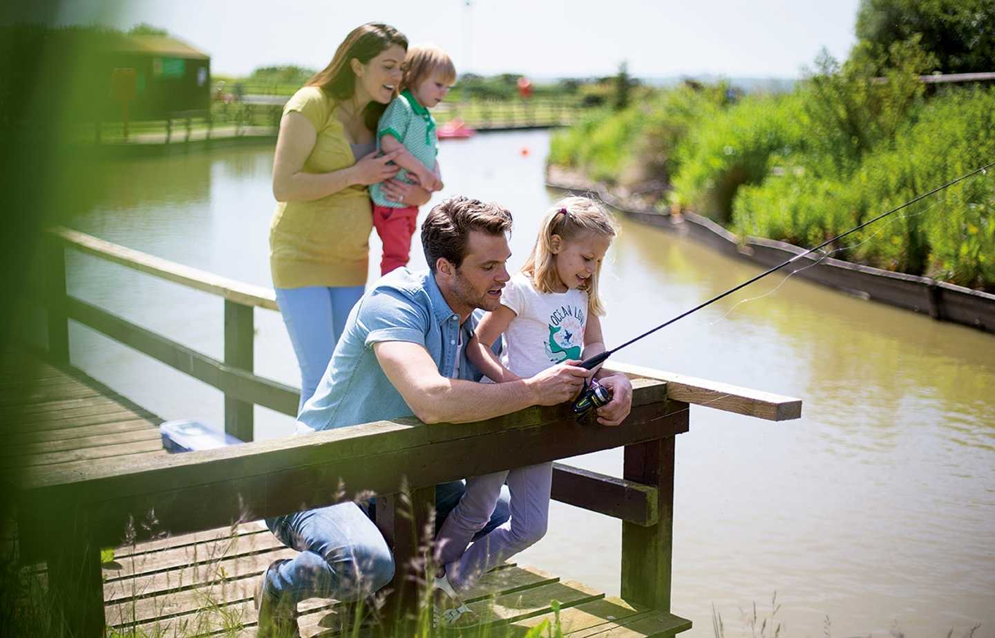 A family fishing on the fishing lake