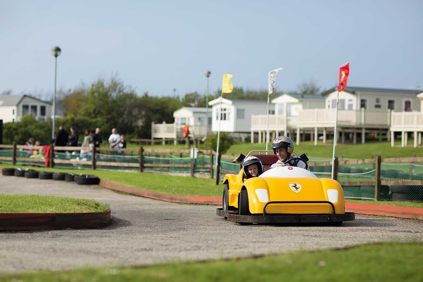 Father and son racing on the go-kart track