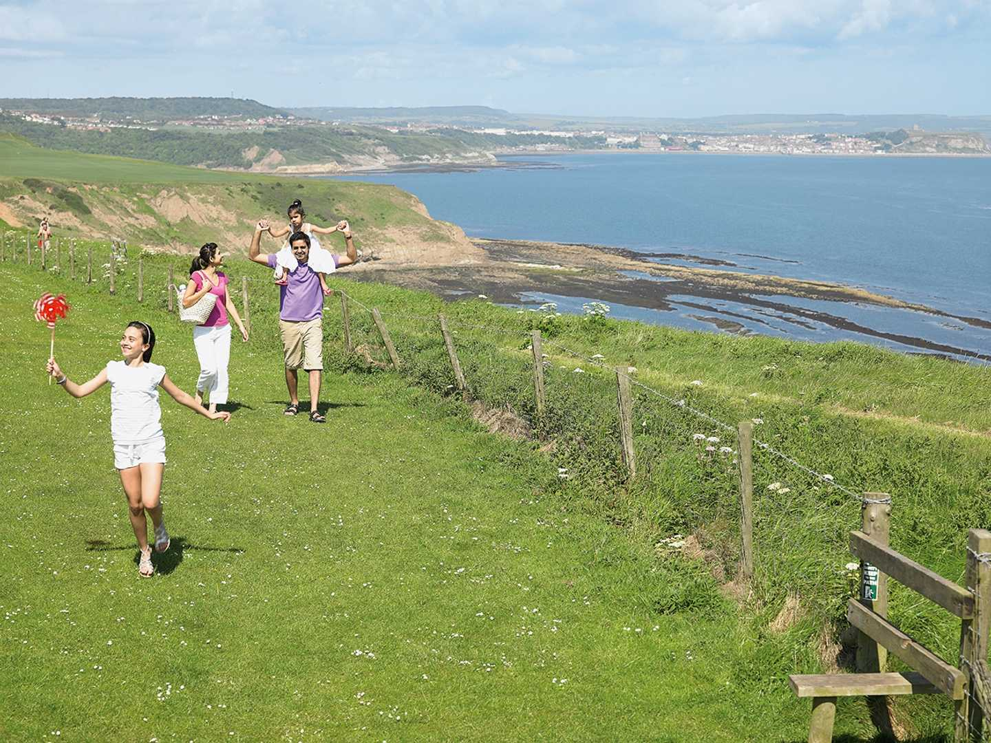A family enjoying the clifftops at Blue Dolphin