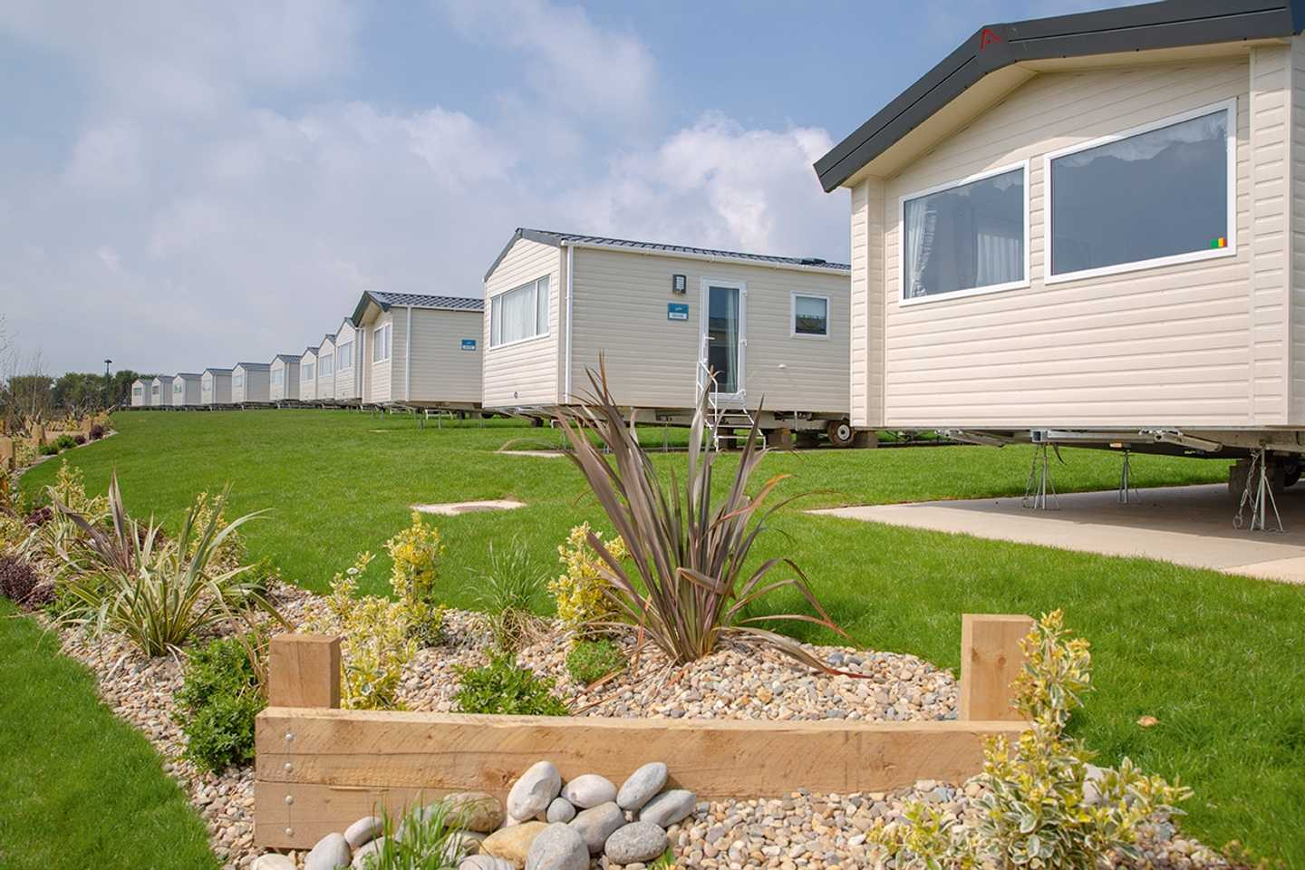Row of the Deluxe accommodation at Wold Vale