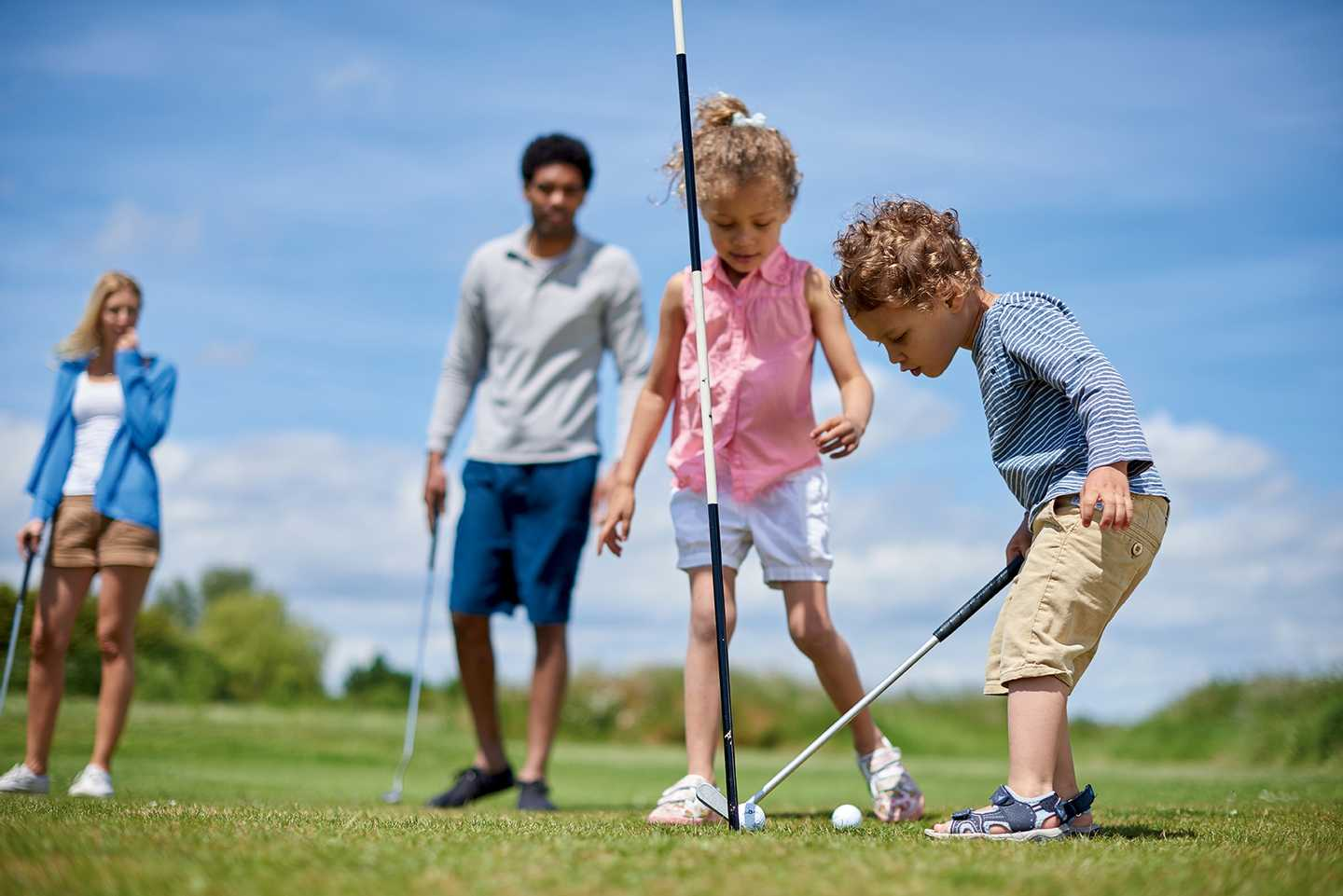 A family playing golf