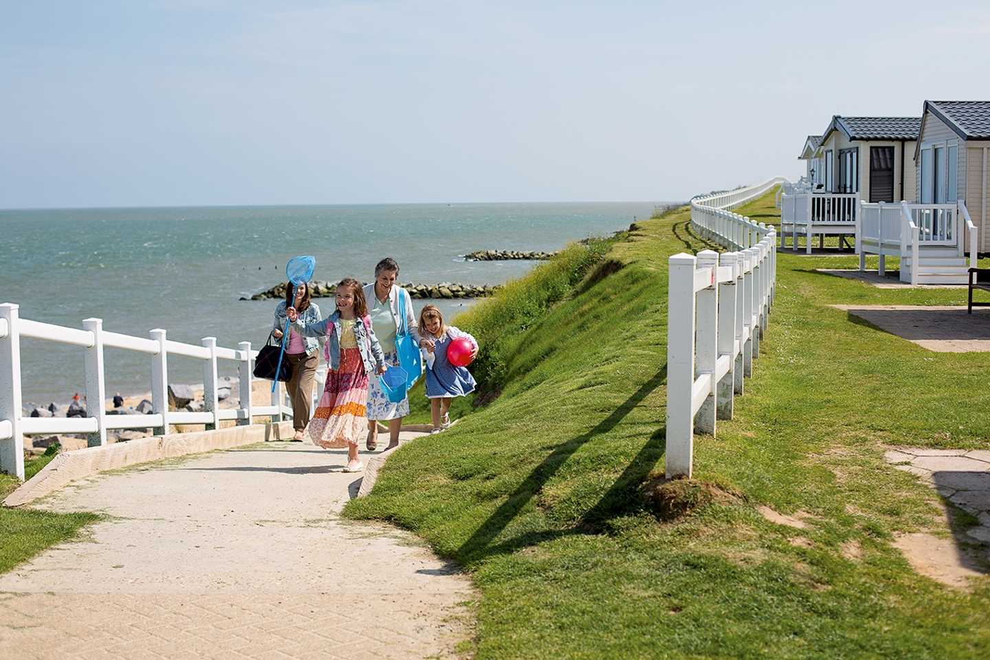 A family walking back from the beach via the direct access walkway
