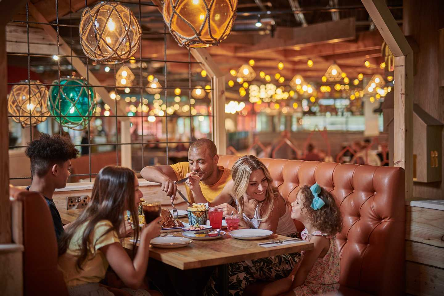 Enjoy a meal in one of our treehouses in the Coast House bar and grill