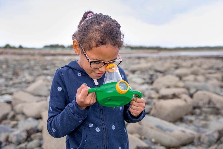 A girl exploring on the beach