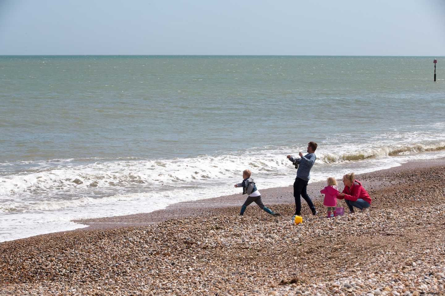 A family exploring Church Farm's beach