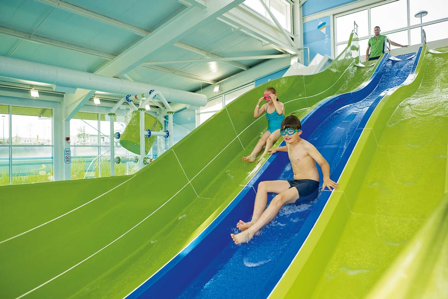 Guests whooshing down the indoor water slide