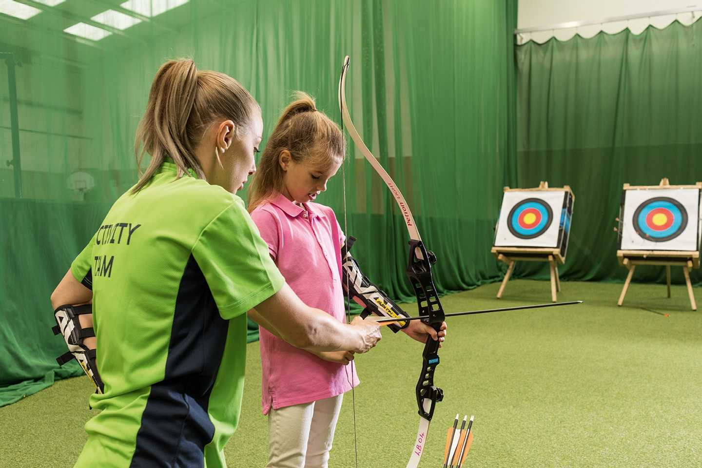 Family playing indoor archery