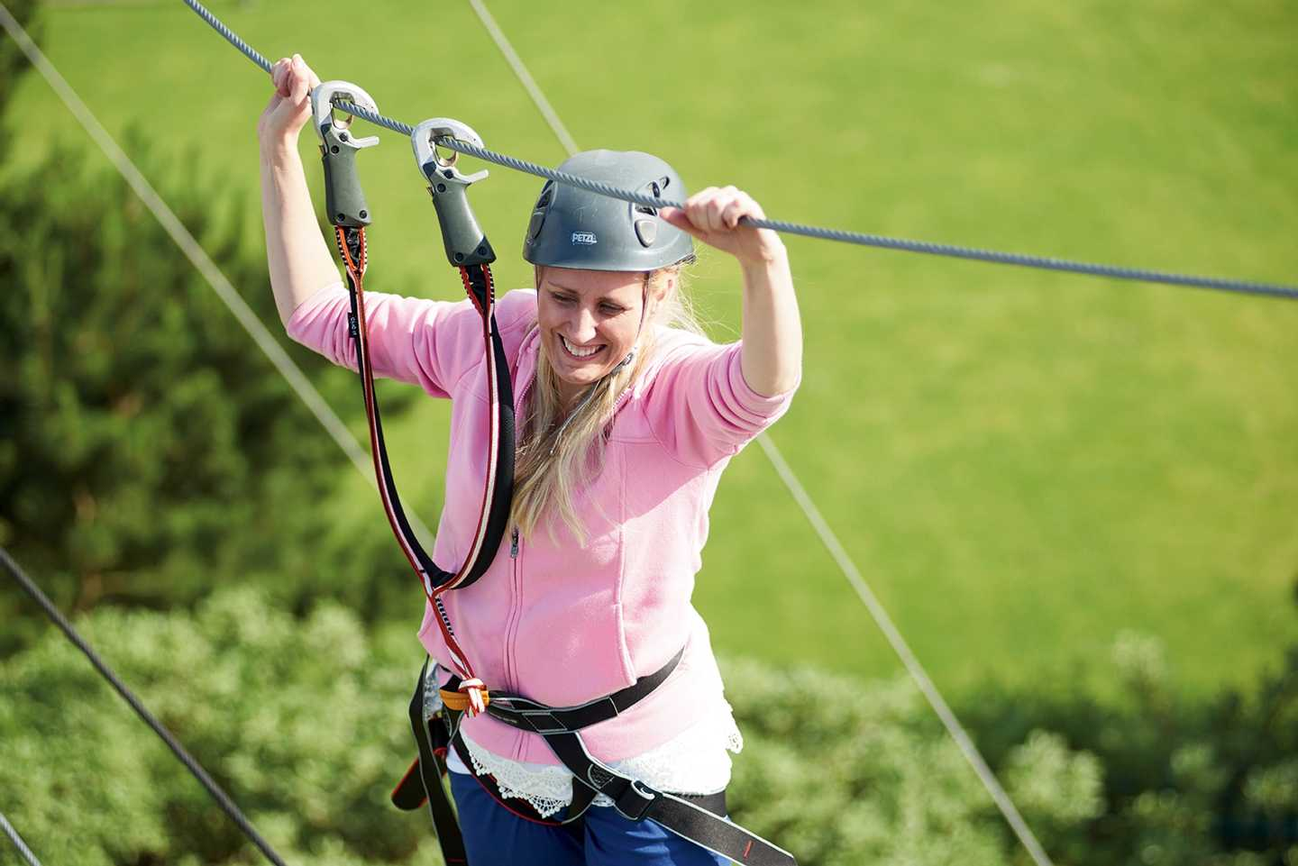 An older guest using the ropes course at Golden Sands