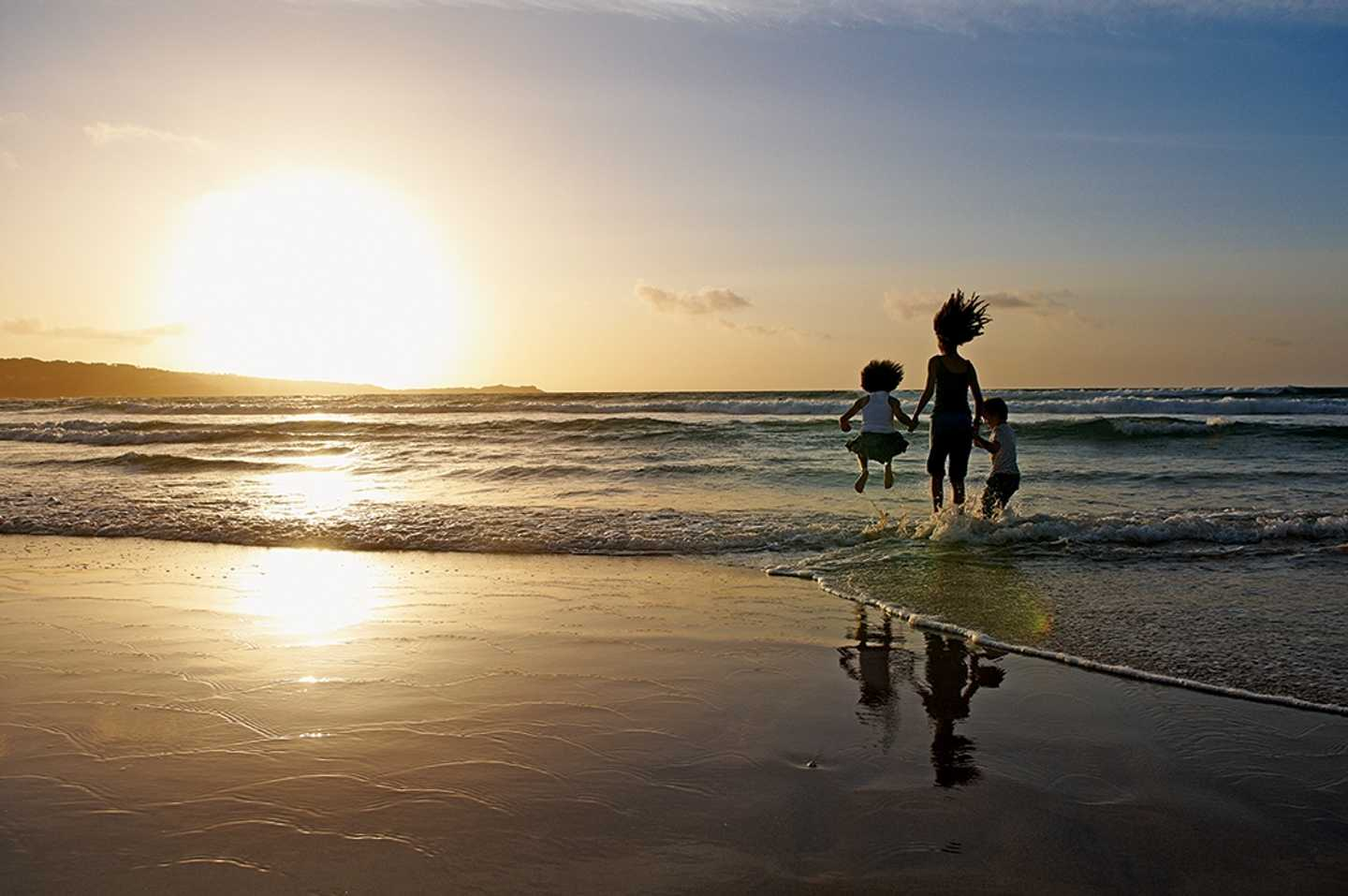 Kids on the beach in Cornwall at sunset