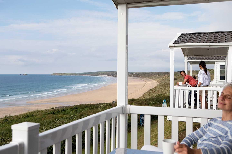A woman relaxing on her veranda