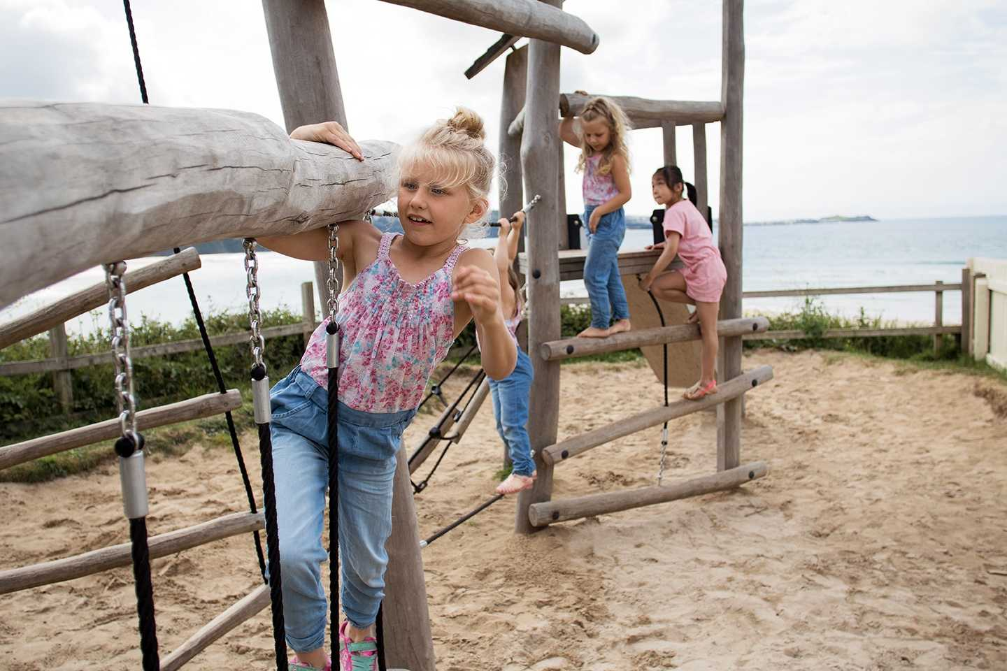 Children playing in the outdoor play area