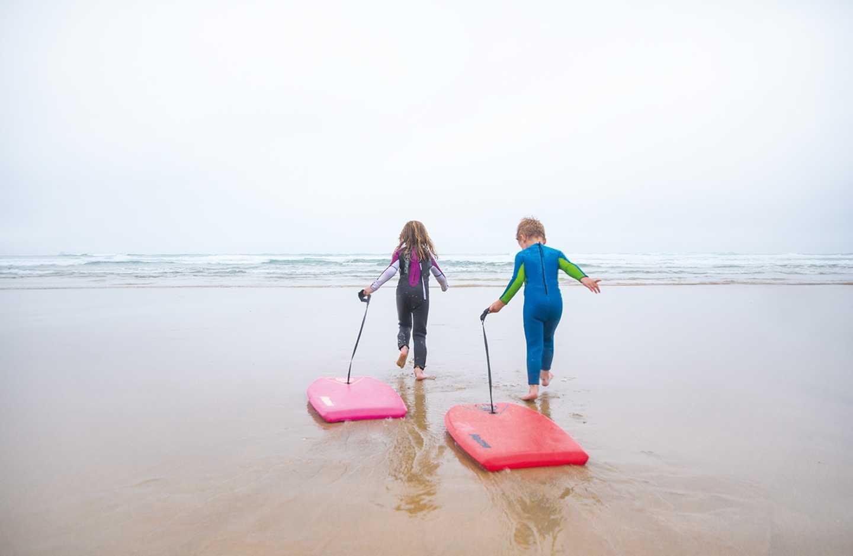 Children running into the sea