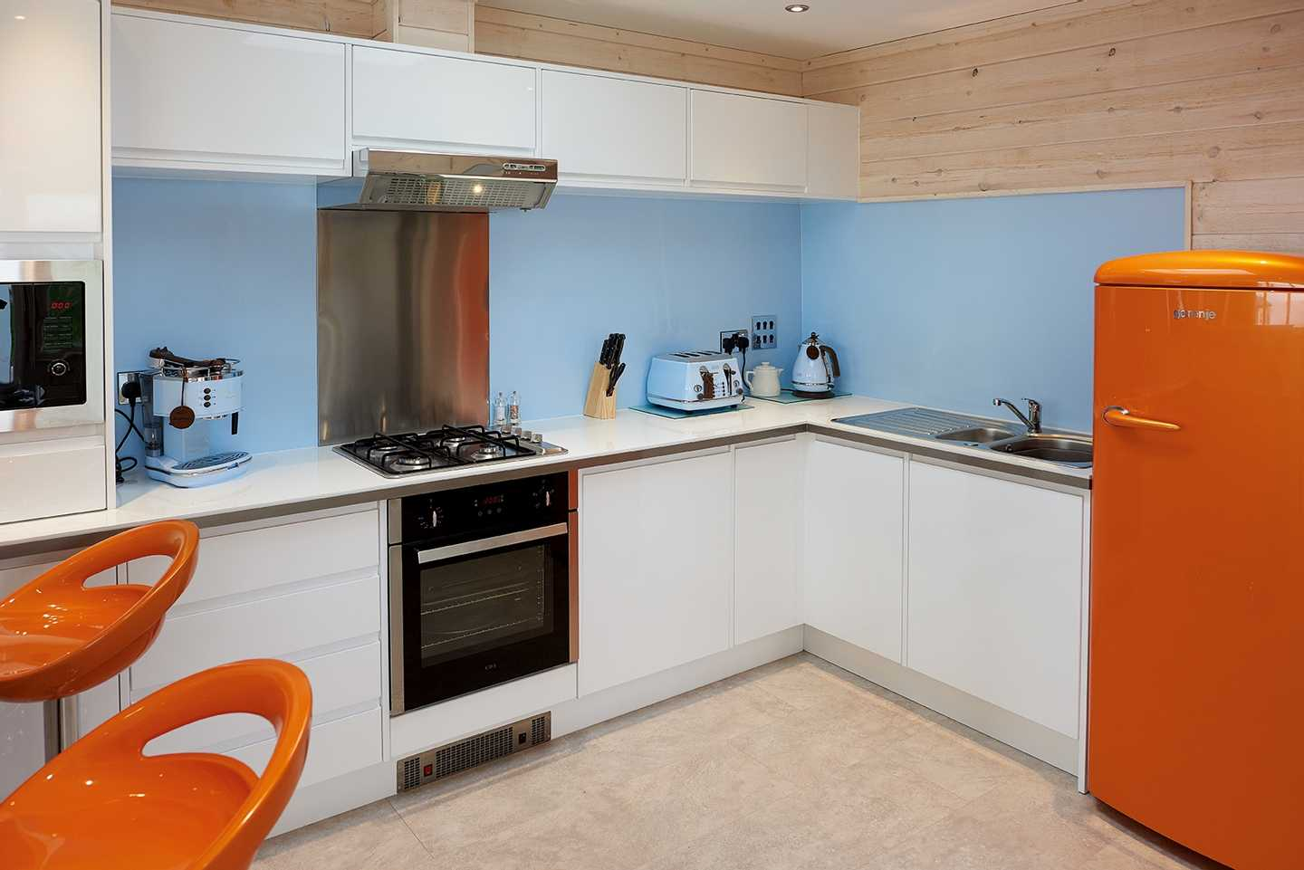 A Beach House kitchen with fridge, cooker, sink, toaster, kettle and coffee machine